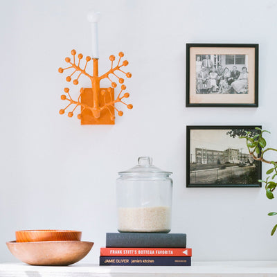 Nini papier mache wall light in orange
