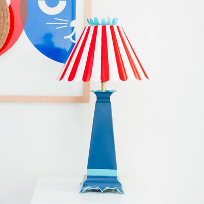 red and blue Norma Lamp, Stray Dog Designs, striped shade, flower top