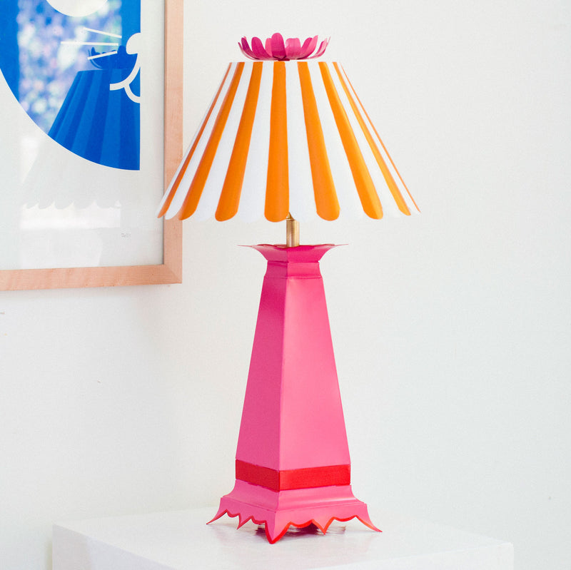 Norma tole lamp with stripey shade in pink and orange, flower finial