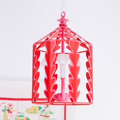 red hanging lantern with pink trim by Stray Dog Designs