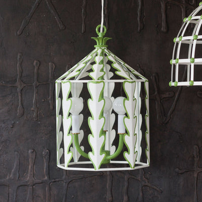 round lantern shaped ceiling light with white leaves and green trim