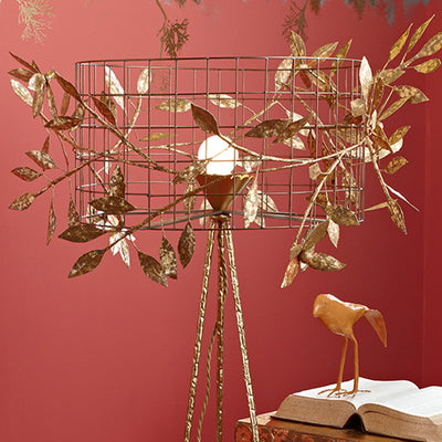 Beautiful Floor Light with wild vine twined thru cage shade.