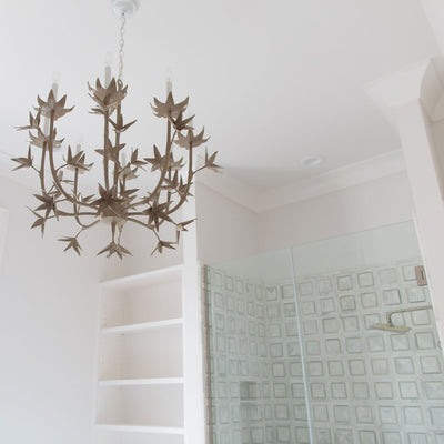 Melissa Chandelier in designer bathroom, beautiful flower motif in gray