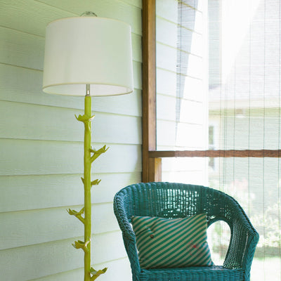 Funky Floor Lamp in yellow papier mache on pretty porch