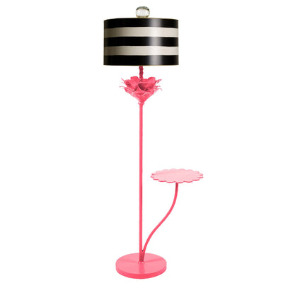 Pink papier mache floor light with black and white striped shade.