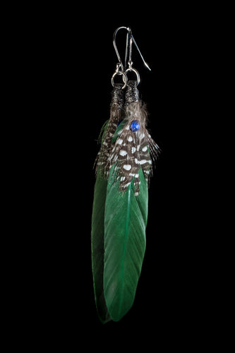 green feather earrings on sterling silver