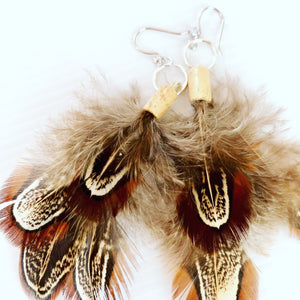 Feather and silver earrings