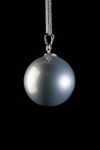 Pearl shell pendant on silver chain
