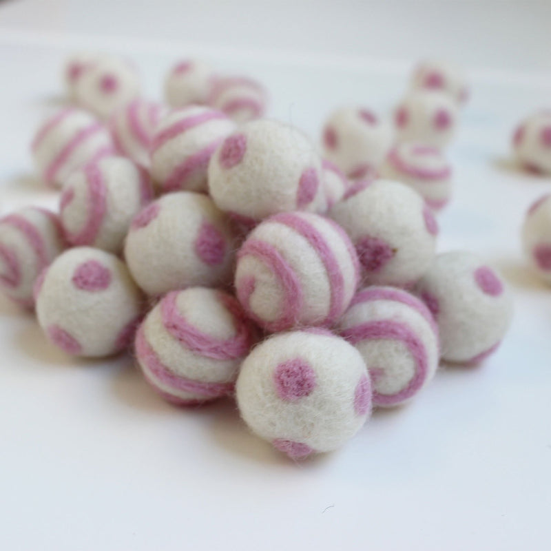pink on white polka dot swirl felt balls