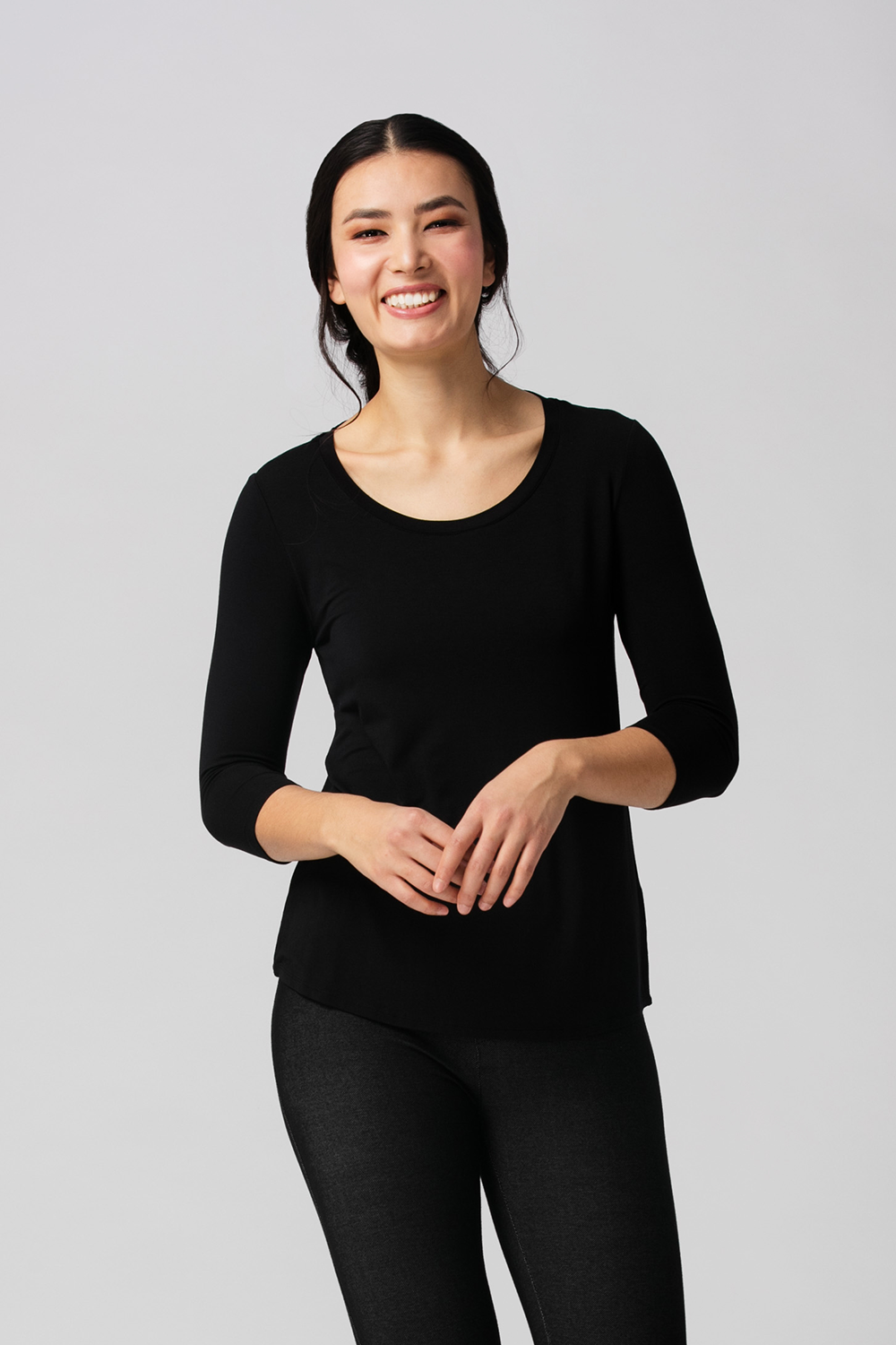 The Ava 3/4 Sleeve is a basic that makes you look and feel great. Made from silky soft Bamboo, featuring a flattering scoop neck line and curved hem line for more coverage in the back. The Ava 3/4 Sleeve top is both feminine and flattering and comes in a great selection of colours for any season. Black Fabrication: 95% Viscose from Bamboo, 5% Spandex $55.00