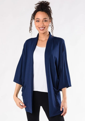 This elegantly oversized kimono cardigan can be worn year-round. The Cadence Cardigan is an open-front cardigan with billowy 3/4 length sleeves and patch pockets. It is just the right length for bum-coverage; style this with your favourite tee or tank top underneath.  Fabrication: 95% Viscose from Bamboo 5% Spandex French Terry TERRERA $115.00 Ink Blue
