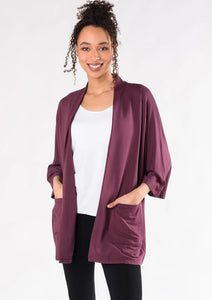 This elegantly oversized kimono cardigan can be worn year-round. The Cadence Cardigan is an open-front cardigan with billowy 3/4 length sleeves and patch pockets. It is just the right length for bum-coverage; style this with your favourite tee or tank top underneath.  Fabrication: 95% Viscose from Bamboo 5% Spandex French Terry TERRERA $115.00 Plum Purple