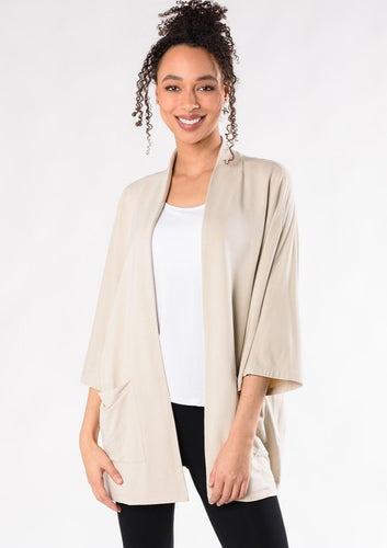 This elegantly oversized kimono cardigan can be worn year-round. The Cadence Cardigan is an open-front cardigan with billowy 3/4 length sleeves and patch pockets. It is just the right length for bum-coverage; style this with your favourite tee or tank top underneath.  Fabrication: 95% Viscose from Bamboo 5% Spandex French Terry TERRERA $115.00 Stone Brown