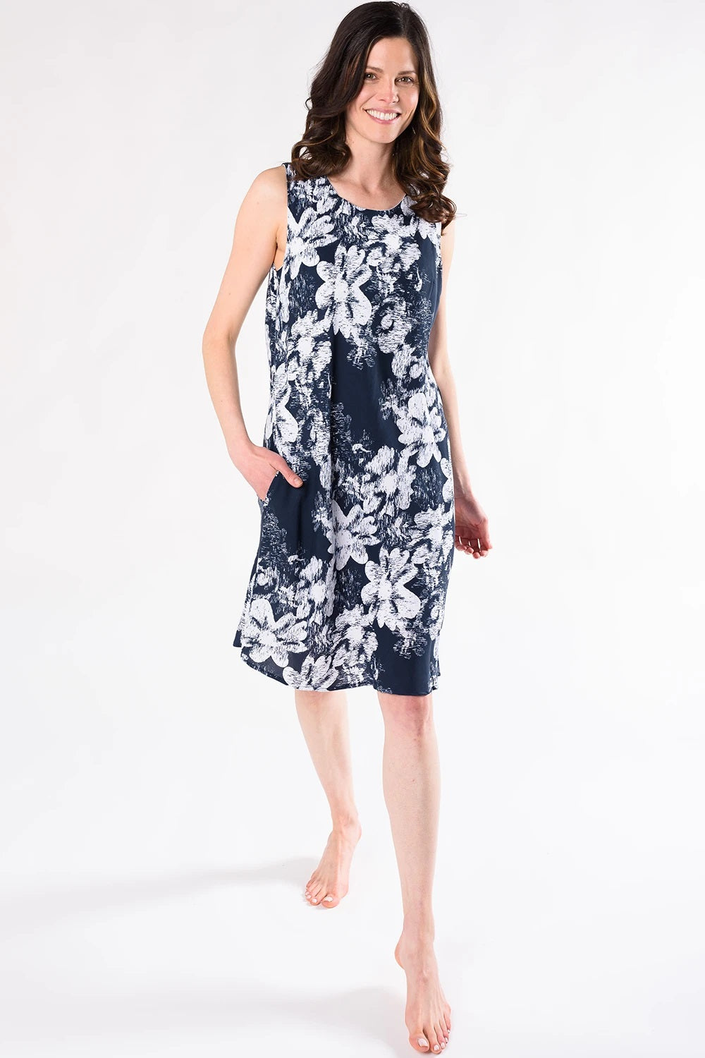 The June Floral Print dress has a scoop neck front, a V-neck back. Made with an easy to wear and smooth woven Tencel fabric that's airy and breathable; it has an elegant seam detail running down the back.  Fabrication: 100% Tencel TERRERA $155.00 Ink Blue