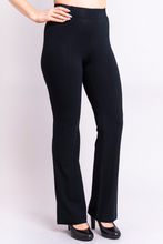 Create a slim line with the Aysha pant in cool bamboo and cotton. Narrow through hip and thigh, they have a slight flare to balance the silhouette. A light seam down front and back elongates and adds subtle texture. The fabric waistband at front and back combines with flat elastic at either side to ensure a smooth look and comfortable wear. Aysha pants provides freedom of movement with great contemporary style and a clean line.  Fabric - 67% Bamboo, 28% Cotton, 5% Lycra  BLUE SKY $$85.00 colour black