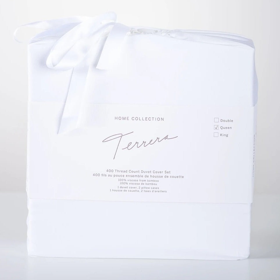 We spend one third of our lives in bed, so why not choose the best? Slip under the ultra-soft and cool-to-touch Terrera Luxury Duvet & Pillowcase Set. Made with their signature viscose from bamboo, which is comfortable, breathable, and oh so soft - an excellent option for those with sensitive skin. Includes 400 thread count Duvet Cover with snap closures at the bottom,4 ties inside to hold duvet in place and 2 pillow cases.  Fabrication: 100% Viscose from Bamboo TERRERA White $150/$160/$190