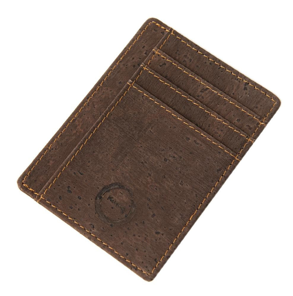 The Cork Card Holder is crafted from vegan and sustainable cork. This sleekly designed card holder features 6 card slots, 1 transparent holder for ID and a center slot for cash or more cards.  KUMA $34.00 colour Brown