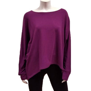 A throw on your body and go piece; the French Terry Sweatshirt has a high/ low hemline, loose Dolman sleeves. Made of Bamboo it is cool in the summer and warm in the winter making it an excellent choice that can be worn all year round.   Fabrication: 66% Bamboo, 28% Cotton, 6% Spandex   GILMOUR $90.00 colour boysenberry purple