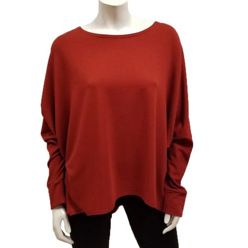 A throw on your body and go piece; the French Terry Sweatshirt has a high/ low hemline, loose Dolman sleeves. Made of Bamboo it is cool in the summer and warm in the winter making it an excellent choice that can be worn all year round. (One Size)  Proudly Made in Canada  Fabrication: 66% Bamboo, 28% Cotton, 6% Spandex   GILMOUR Rust Orange $90.00