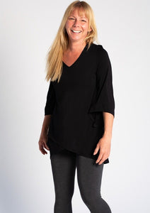 The Kinsley Tunic is a beautiful A-line tunic with a cross-over front that fits and flatters the body.  Kinsley features a V-neckline, airy bracelet-length sleeves for movement and cross-over hem. Easily complete your outfit with a pair of leggings. Fabrication: 95% Viscose from Bamboo 5% Spandex TERRERA colour black $85.00