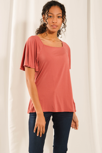Update your closet with the Leanne Square Neck Top. The fluttery sleeves provide flattering arm coverage and add a feminine touch, giving your outfit an elegant look. The square neckline is perfect for pairing with your favourite bold necklace! Fabrication: 95% Viscose from Bamboo 5% Spandex LNBF Colour dusty rose pink $65.00
