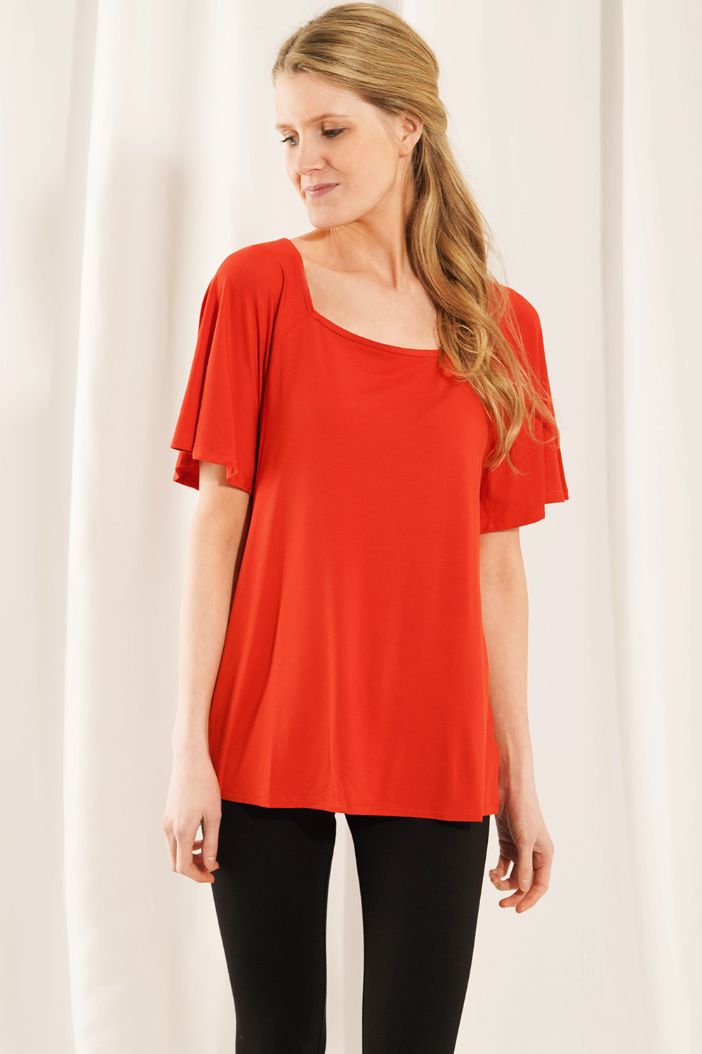 Update your closet with the Leanne Square Neck Top. The fluttery sleeves provide flattering arm coverage and add a feminine touch, giving your outfit an elegant look. The square neckline is perfect for pairing with your favourite bold necklace! Fabrication: 95% Viscose from Bamboo 5% Spandex LNBF Colour Tigerlily Orange $65.00