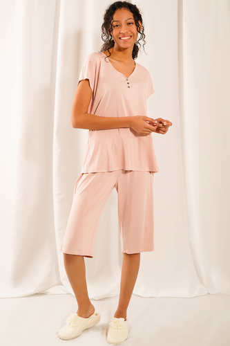 Feel blissful, look lovely and sleep easy in the Luna Sleep Set. Made with bamboo viscose fabric is not only silky-soft, but helps regulate body temperature by keeping you cool at night. Features a dainty button up v-neckline and short sleeves top that pairs with a loose-fitting wide leg shorts with drawstring.  Fabrication: 95% Viscose from bamboo, 5% Spandex  LNBF colour English rose $70.00