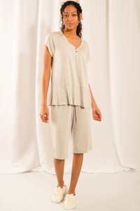 Feel blissful, look lovely and sleep easy in the Luna Sleep Set. Made with bamboo viscose fabric is not only silky-soft, but helps regulate body temperature by keeping you cool at night. Features a dainty button up v-neckline and short sleeves top that pairs with a loose-fitting wide leg shorts with drawstring.  Fabrication: 95% Viscose from bamboo, 5% Spandex  LNBF colour grey melange $70.00