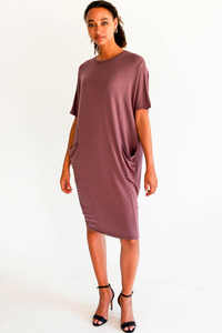 Wrap yourself in the cozy soft Mika Dress. Comfortable, relaxed fit, this drop shoulder French Terry piece will be your new favorite new dress! Features seam lines, seam pockets and a flattering and trendy cocoon shape.  Fabrication: 95% Viscose from bamboo, 5% Spandex French Terry  LNBF color mauve purple $115.00