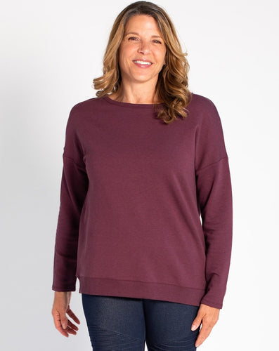 Simple on the front, totally unique on the back! The Riley Crossover Sweater has cross-over panels as well as a keyhole detail on the back. Made this with a cozy bamboo fleece fabric that provides natural insulation to the body.   Fabrication: 66% Viscose from bamboo, 28% Cotton, 6% Spandex TERRERA $95.00 colour Plum Purple