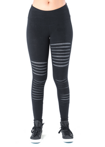 Soon to be your favorite pair of leggings for the season, these leggings really give an edge to everything you put on. And you know how we love edges! The asymmetrical slashes are cool as heck.  Fabrication: Terry 53% Soy 43% Organic Cotton 4% Spandex  NOMADS Colour Black
