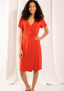 The elegant Taya Wrap Dress raises the bar on style and comfort. The fixed tie-waist detail means that you can easily slip the dress over your body! With sleeves for coverage, a flattering V-neck, and a side slit for movement, you will Love wearing this dress! Fabrication: 95% Viscose from bamboo, 5% Spandex   LNBF color tigerlily orange $95.00