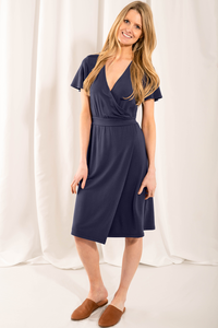 The elegant Taya Wrap Dress raises the bar on style and comfort. The fixed tie-waist detail means that you can easily slip the dress over your body! With sleeves for coverage, a flattering V-neck, and a side slit for movement, you will Love wearing this dress! Fabrication: 95% Viscose from bamboo, 5% Spandex   LNBF colour twilight blue $95.00