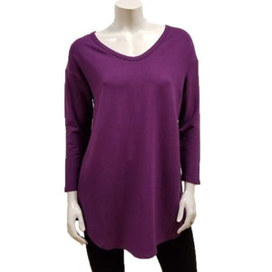 The Tori Tunic has a soft banded V-neckline, 3/4 sleeves, slight A-line shape, and a softly rounded hemline make this the best tunic for your weekends! Or, any day-ends!   Fabrication: 66% Bamboo, 28% Cotton, 6% Spandex  GILMOUR $95.00 colour boysenberry purple