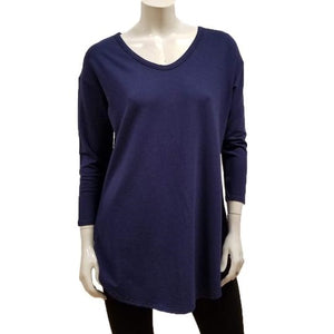 The Tori Tunic has a soft banded V-neckline, 3/4 sleeves, slight A-line shape, and a softly rounded hemline make this the best tunic for your weekends! Or, any day-ends!   Proudly Made in Canada  Fabrication: 66% Bamboo, 28% Cotton, 6% Spandex  GILMOUR $95.00 Colour Flight Blue