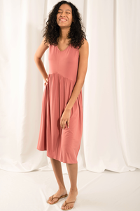 The effortless Diane Midi Dresses A-line silhouette is an Eco-friendly summer staple. Made with soft and silk-like viscose from bamboo, this sleeveless dress has a v-neckline and a drop waist design that creates a long and flattering silhouette.  Fabrication: 95% Viscose from Bamboo, 5% Spandex LNBF Colour Dusty Rose Pink