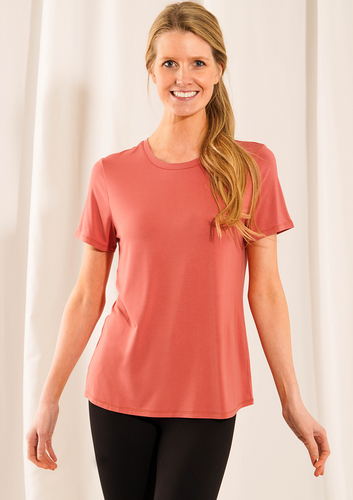 Casual, classic and chic, the Gracie Crew Neck Tee is made with 95% bamboo. This versatile tee features a classic crew neckline that can easily look dressy or casual! Pair this tee with your favorite pair of denim for an easy casual look, or dress it up with your favorite skirt and some fun jewelry for an elegant look!  Fabrication: 95% Viscose from Bamboo 5% Spandex LNBF-colour Dusty Rose Pink