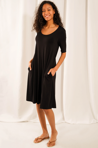 The universally flattering Jill 3/4 sleeve Dress with pockets is sustainably made. Your skin will fall in love with the breathable and soft fabric. A curved neckline and A-line silhouette allows for maximum comfort and movement. Our favourite feature: pockets!  Fabrication: 95% Viscose from bamboo, 5% Spandex  LNBF Colour Black $95.00