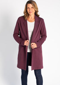 The Meghan Blazer will take you from work to the weekend. This beautifully crafted   open-front blazer with a cozy and warm bamboo fleece fabric that feels as soft as your favorite PJs. This long sleeve sweater blazer with pockets will be your staple piece this season. Fabrication: 66% Viscose from bamboo, 28% Cotton, 6% Spandex TERRERA color plum purple $135.00