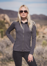 For those who ride…the Evo Jacket is motto magnificent in thick bamboo and organic cotton. Get the wind in your hair with the zip-up classic oriental style motto collar with rivet bling in the back. Two zippered pockets to keep your gear safe, and cool body armor styling on the shoulders and sides.  Fabrication: 67% Bamboo 28% Organic Cotton 5% Spandex NOMADS Colour Shale Grey