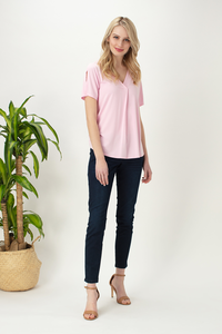 The Ivy Cross Blouse is both dressy and casual, pair it with  capri pants or a cute skirt.  The Cross V neckline, elegant split sleeve and rounded hemline adds a touch of class. Fabrication: 95% Viscose from Bamboo 5% Spandex LNBF Colour Lotus Pink