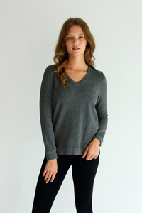 The Perrie V Neck Pullover will hug your body and keep you warm any season. The Bamboo Fleece fabrication is ultra-soft and comfortable. A classy V neck, and high-low hem will leave you feeling chic in your comfort. Fabrication: 66% Viscose from Bamboo 28% Cotton 6% Spandex LNBF Colour Dark Shadow Grey $99.99