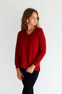 The Perrie V Neck Pullover will hug your body and keep you warm any season. The Bamboo Fleece fabrication is ultra-soft and comfortable. A classy V neck, and high-low hem will leave you feeling chic in your comfort. Fabrication: 66% Viscose from Bamboo 28% Cotton 6% Spandex LNBF Colour Ruby Red $99.99