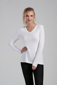 If a V-neck line is your style, you will love the Florence V-Neck Long Sleeve Top. A basic go-to, with a classic silhouette that falls gently over the body and a flattering V-neck line. Wear the Florence V-neck as a layering piece or dress it up with accessories to complete any outfit. Colour White Fabrication: 95% Viscose from Bamboo, 5% Spandex
