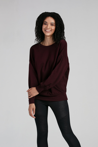 The Roxanne Pullover is bound to become a wardrobe favorite, with its voluminous sleeves and banded hem line, it is cozy and comfortable. The Roxanne Pullover is reversible and looks great paired with Leggings or styled with your favorite jeans Fabrication: 66% Viscose from Bamboo, 28% Cotton, 6% Spandex  LNBF Colour Fig $99.99