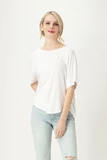 Easy does it with our Elsa Relaxed Fit Blouse. Casual elegance and comfortable. This top features a relaxed fit body, curved hem detail, forward to front seams, and a universally flattering boat neck. The Elsa blouse is sure to be your favourite all occasion tee! Fabrication: 95% Viscose from Bamboo 5% Spandex LNBF Colour White