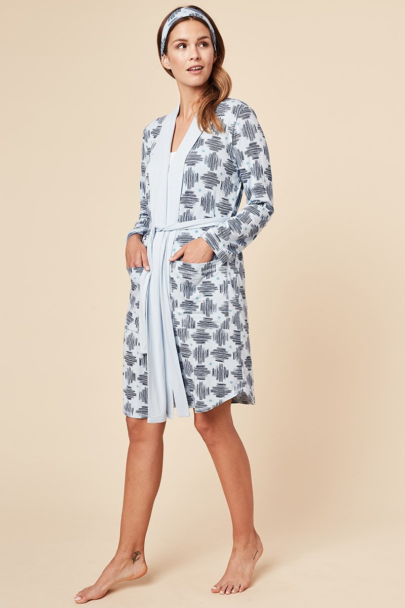 For lounging, getting ready to start your day or even ending it, this soft and breathable Shannon bamboo robe is what you'll always want to be wrapped up in. This robe features deep pockets, a long belt, wide lapel to adjust the way you wrap the robe around your body, and a matching headband. Made from our signature moisture wicking bamboo/spandex fabric. Proudly Made in Canada Fabrication 93% Bamboo Viscose 7% Spandex This Is J Colour Blue Hatch