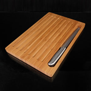 "15"" X 7"" Made with Bamboo the Bread Board with Fitted Knife has lined ridges throughout to help guide the slices when cutting loaves of bread. They also double as great crumb catchers. The serrated knife is sharp and great for slicing bread. VERDICI $40.00"