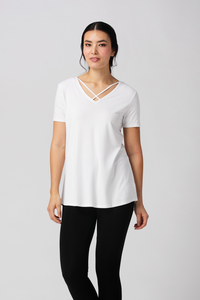 The Bamboo Kimberly tunic is both casual and comfortable, it features a high low hem, flattering Vneck with cross details and a scoop neckline at the back. Wear your Kimberly tunic with a pair of white jeans or some leggings to run errands. White Fabrication: 95% Viscose from Bamboo, 5% Spandex $38.49