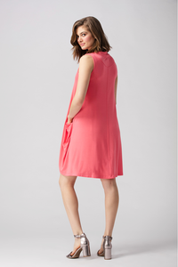 The Delilah Dress has a V neckline with collar and a A-Line shape with pockets. Colour Coral Fabrication: 95% Viscose from Bamboo, 5% Spandex LNBF